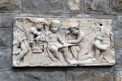 Bas-relief marble sculpture with babies Royalty Free Stock Photos