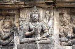 Bas-relief of meditating Buddha, Prambanan, Yogyakarta, Java, In. Ancient stone bas-relief of meditating Buddha, Shrine of Prambanan hindu temple, Yogyakarta Stock Images
