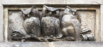 Bas-relief with owls. Warsaw. Poland Stock Photo