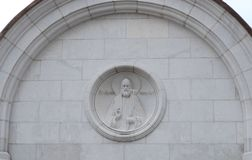 Bas-relief `Patriarch Tikhon` on the wall at the entrance to the Church of the Transfiguration of the Lord in the complex of the C stock photo