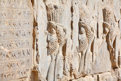 Bas-relief of Persian soldiers stock photos