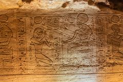 Bas relief of the Pharaoh kneeling before Horus royalty free stock photos