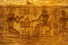 Bas relief of Ramesses II as pharaoh and god stock image