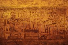 Bas relief of Ramesses II giving offer to Anubis. In the Great Temple of Abu Simbel royalty free stock photos