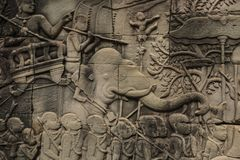 Bas-relief Sculpture at Bayon temple, Angkor Wat, Siem Reap, Cambodia royalty free stock photography