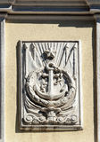Bas-relief of ship's anchor on the old wall Stock Photo