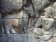 Bas Relief showing the different stage of the life of Lord Buddha towards Nirvana, Borobudur Temple, Central Java, Indonesia Stock Photo