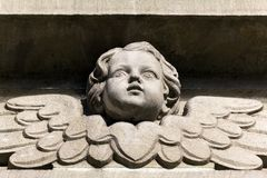 Bas-relief of a small angel on facade of church Royalty Free Stock Photo