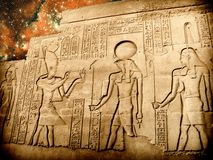 Bas-relief of Sobek temple at Kom-Ombo and small Magellanic Clou Royalty Free Stock Photo