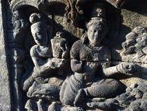 Bas Relief som visar den olika etappen av livet av Lord Buddha in mot nirvana, Borobudur tempel, centrala Java, Indonesien Arkivfoton
