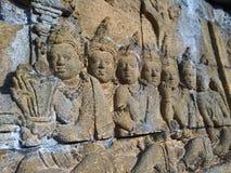 Bas Relief som visar den olika etappen av livet av Lord Buddha in mot nirvana, Borobudur tempel, centrala Java, Indonesien Royaltyfri Bild