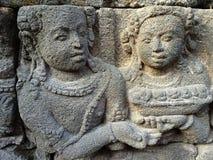 Bas Relief som visar den olika etappen av livet av Lord Buddha in mot nirvana, Borobudur tempel, centrala Java, Indonesien Arkivbild