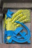 Bas-relief of the Soviet era patriots painted in colors of Ukrainian flag. Kiev stock photography