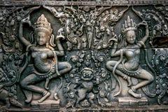Bas Relief Statue da cultura do Khmer em Angkor Wat foto de stock