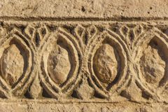 Bas-relief. stone architectural frieze with geometric patterns: abstract ornament.  Italy Apulia. Detail of an architectural frieze of a drywall Royalty Free Stock Photography