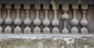Bas relief of stone balustrade with one banister inverted.  Royalty Free Stock Photo