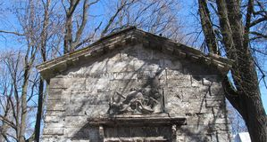 Bas-relief on an  stone building stock images