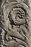 The bas-relief on the stone. Bas-relief in the form of floral ornament on a stone Stock Image