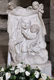 Bas-relief stone madonna with child Stock Photo