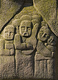 The bas-relief on the stone. People Stock Images