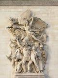 Sculpture of `Le depart, detail of Arc de Triomphe, Paris. Bas relief stone Sculpture of `le depart` by antoine etex, detail of Arc de Triomphe, Paris Royalty Free Stock Images