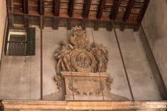Bas-relief under the arch of Domus Nova in Piazza della Signoria in Verona, Italy stock images