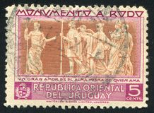 Bas relief. URUGUAY - CIRCA 1948: stamp printed by Uruguay, shows Bas relief, circa 1948 Stock Photos