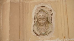 Bas-relief of the Virgin on the front wall of building, Valletta, Malta.  Royalty Free Stock Photo