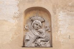 Bas-relief Virgin Maria with child on beige vintage  background. Face mother with baby royalty free stock photography