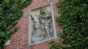 Bas-relief of the Virgin Mary and Child on the gate of a Gothic castle Malbork in Poland royalty free stock photography