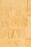 Bas-relief on wall in Egypt. Temple between the Valley of Kings and the Valley of Queens, Luxor, Egypt, Temple of Queen Hatshepsut in Luxor Royalty Free Stock Photography