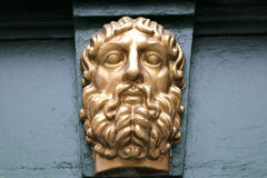The bas-relief on the wall man face Royalty Free Stock Images