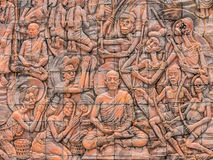 Bas-relief wall in Phu-tok  Temple, Bueng kan, Thailand Royalty Free Stock Photo