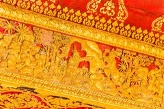 The bas-relief on the wall of the temple in Louangphabang, Laos. Close-up. Royalty Free Stock Images