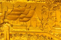 The bas-relief on the wall of the temple in Louangphabang, Laos. Close-up. Royalty Free Stock Photo