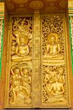 The bas-relief on the wall of the temple in Louangphabang, Laos. Close-up. Vertical. Royalty Free Stock Image