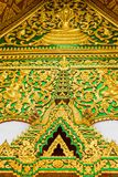 The bas-relief on the wall of the temple in Louangphabang, Laos. Close-up. Vertical. Royalty Free Stock Photos
