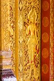The bas-relief on the wall of the temple in Louangphabang, Laos. Close-up. Vertical. Royalty Free Stock Images
