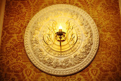 Bas-relief on the wall under the lamp Royalty Free Stock Photos