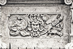 Bas-relief in white marble on a building facade Stock Photography