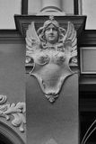 Bas-relief of a woman with wings and a star on the wall of an ol Royalty Free Stock Image