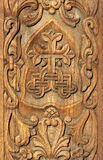 Bas relief in wood Stock Photos