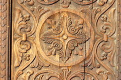 Bas relief in wood - carved wooden door. Wooden background Stock Photography