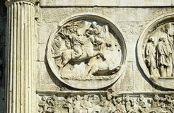 Bas-reliefs of the Arch of Constantine. Bas-reliefs and sculptures on the triumphal arch of the Constantine emperor in Rome Royalty Free Stock Photography