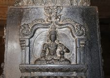 Bas-reliefs on the basalt columns of the Vittala Temple in Hampi, Karnataka, India. Unesco World Heritage Site. The famous tourist destination from GOA Stock Image