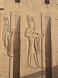 Bas reliefs on Edfu temple - god Edfu. Bas relief of god Horus, falcon headed man, Edfu, Egypt, Africa Stock Photos