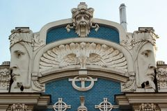 Bas reliefs on facade of buildings in Riga, Latvia. RIGA, LATVIA - JULY 11, 2017: Bas reliefs on facade of buildings in Art Nouveau style, located in historical Stock Images