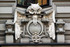 Bas reliefs on facade in Riga, Latvia. RIGA, LATVIA - JULY 11, 2017: Bas reliefs on facade of buildings in Art Nouveau  style, located in historical `Quiet Royalty Free Stock Image