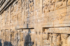Bas-reliefs at the galleries and walls of Borobudur  temple Royalty Free Stock Photo