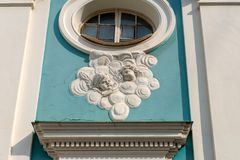 Bas-reliefs with images of angels. On the facade Armenian Church of St. Catherine near Nevsky Street in St. Petersburg Stock Image